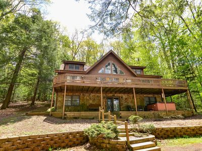 Log style dog friendly home w/ split lakefront, hot tub, and fire pit!