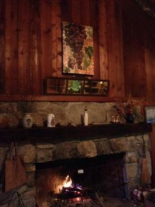 A magnificent mountain stone fireplace lends cheer and welcome