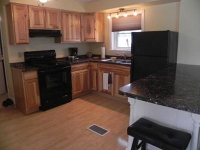Modern kitchen with all new appliances: stove, coffee maker, toaster and more..