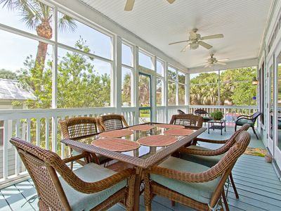 Furnished Screened Porch off Living Area with Outdoor Dining Seating for 6