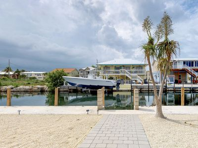 Photo for NEW LISTING! Charming, waterfront getaway w/ a furnished patio, balcony, & dock