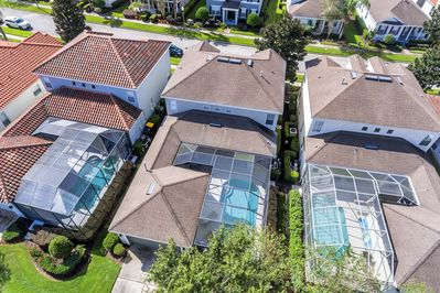Shows large covered lanai area by pool - walk way to garage - fully landscaped
