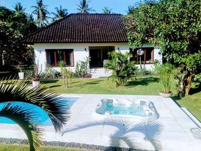 Photo for 2BR Villa Paradise with swimming pool and jacuzzi near the beach of Senggigi.