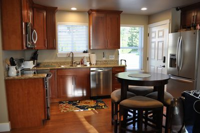 New kitchen with granite counter tops.