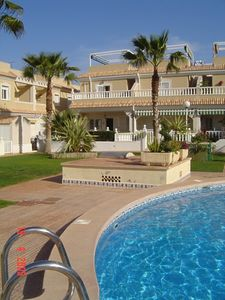 Photo for 3 Bedroom, 2 Bathroom end of terrace House overlooking the pool