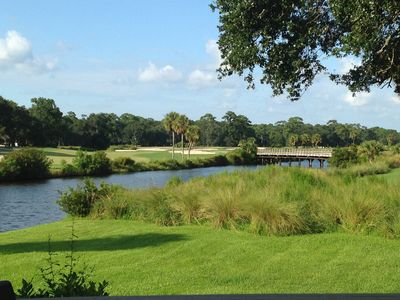 Back porch view of the 7th hole of the Fazio Golf course and lagoon