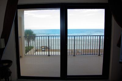 Balcony and Ocean from Sliding Glass Doors in Living Room