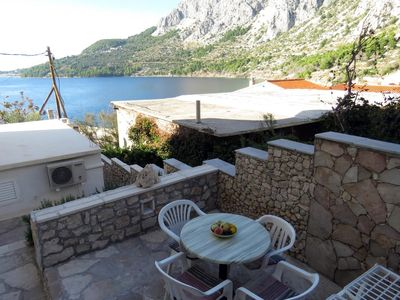 Photo for Two bedroom apartment with terrace and sea view Drašnice, Makarska (A-5265-a)