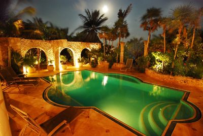 dramatic lit pool area with stone Mayan aqueduct and complete privacy