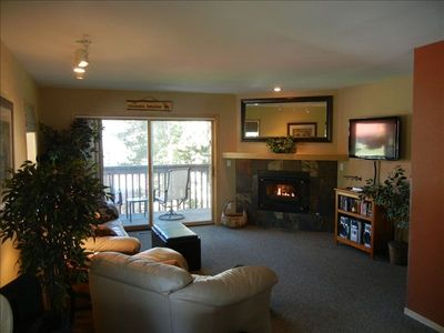 Living Area with Flat Screen TV, Leather Sofa, Chair, Ottoman & Gas Fireplace