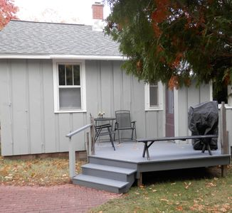 Back entry & deck with sitting area and gas BBQ grill.