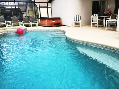 Photo for Disney 5 mins - 4 bed 3 bath pool/hot tub private family home