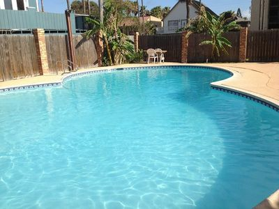 Photo for Second floor walk- up condo. Sleeps 4, 2 bedrooms, 1 bath. Pet-friendly. Shared Pool & BBQ area
