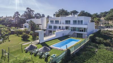 Photo for Beachfront Luxury Villa, w/ heated pool & fence for children, 30 mts from beach