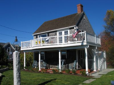 Cottage from front with upper deck and lower patio