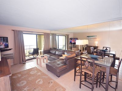 Photo for Cozy, pastel-toned 1 bedroom oceanfront condo with free WiFi and parking located midtown and just steps to the beach!