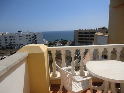 Photo for 3 bed penthouse, 2 x sunny terraces, sea views, wi-fi and on-site heated poo