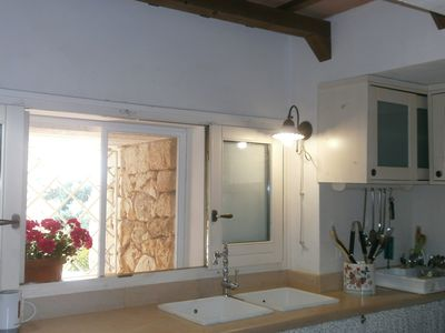 Photo for Trullo villa Giuliana, outstanding view, Free WIFI, beautiful and wide garden