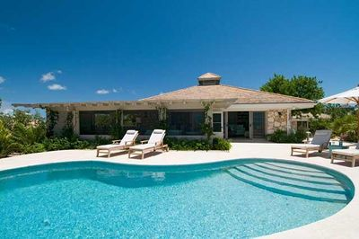 Villa sits high on quiet cliff overlooking the gorgeous clear aqua blue water.