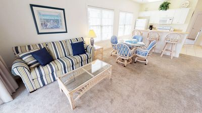 Photo for Sunny End Unit with Screened Porch. Free Parking & WiFi. Close to Beach!