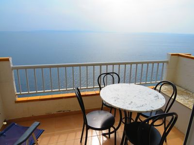 Photo for MEDI. Apartment with incredible views of the Bay of Roses with community pool.