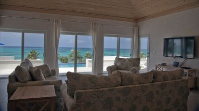 Wall-to-wall sliding glass doors allow clear views of ocean, reef and pool area.