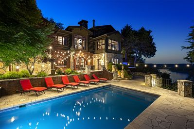 The WHITE RIVER RANCH ESTATE! The rear of home and in-ground heated pool!