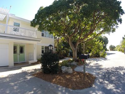 Photo for Quaint cottage just steps from Anna Maria Island's white sand beach.