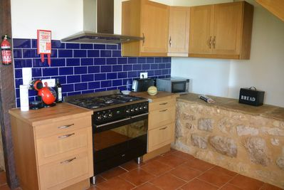 Modern fitted kitchen with range cooker