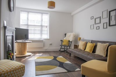 The living room with comfortable seating and smart tv