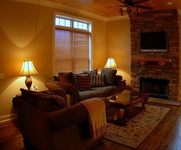 Living Room with Plasma TV and Brick Fireplace
