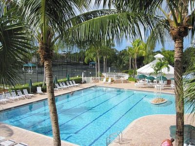 Junior Olympic Swimming Pool and Cabana Grill/Bar surrounded by Palm Trees.