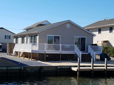 Photo for Charming one story canal front home, quiet neighborhood, one mile from ocean