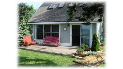 Photo for Crooked Lake Cottage with boat dock and sandy swimming beach!
