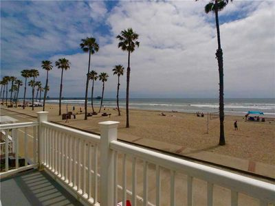 RELAXING DUPLEX ON THE STRAND OF OCEANSIDE JUST A STONES THROW FROM THE BEACH