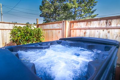 Hot tub - Located on  the outdoor deck, this 6 person hot tub is a perfect way to end a long day at the beach