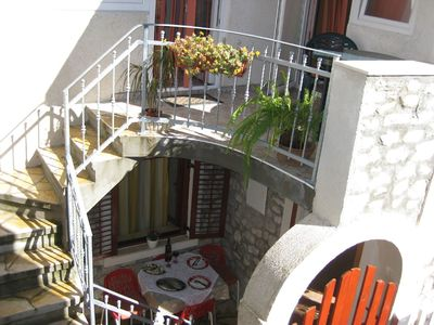 a house view - a first floor terrace and a grill terrace on the ground floor