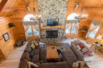 Grandiose Log Lodge with sectional sofa, open floor plan for entertaining