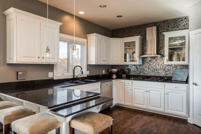 Gourmet Kitchen with beautiful Italian glass wall and superior appliances.