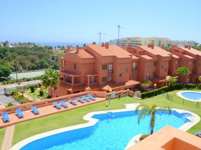 Photo for 3 double bedrooms duplex penthouse with seaviews. Pools and gardens, beachside.