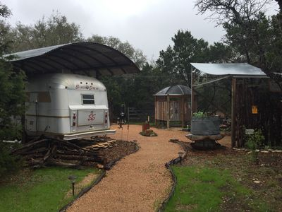 Outdoor amenities include an outdoor shower, picnic area, BBQ setup.