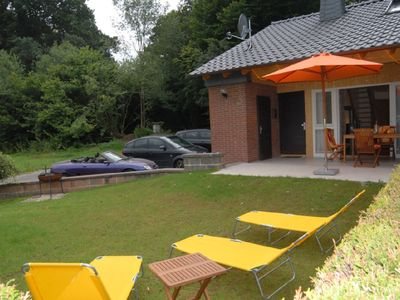 Photo for Fantastic Holiday home with jacuzzi and fireplace at the border of a wood