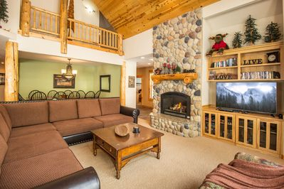 """Great Room / Beautiful River Rock Fireplace / 60"""" HDTV"""