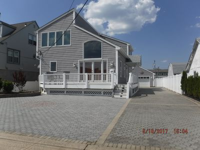 Photo for contemporary home  one block to the beach  inground pool. parking for 10 cars