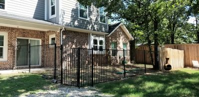 Wrought iron fenced in side yard for pets allowed on a case by case basis.