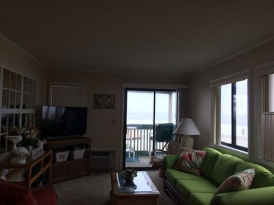 The living area has plenty of windows with a gorgeous view of the beach