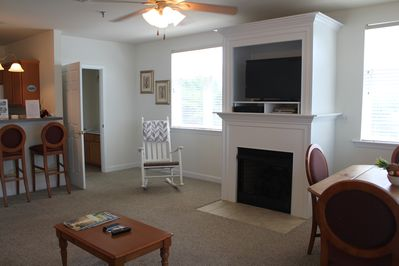 Open living space 1 with gas fireplace and views from 2 sides!