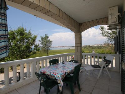 Photo for Two bedroom apartment with terrace and sea view Povljana (Pag) (A-6502-b)