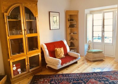 Front room with small balcony windows