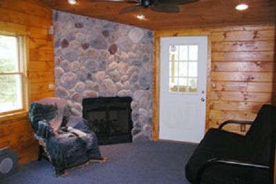 Bass Bunk living room with stone fireplace.